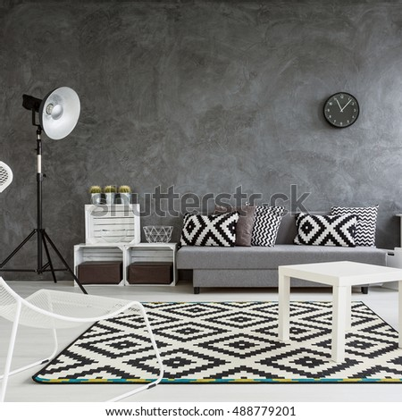 Spacious living room decorated with style. Grey walls, white wooden floor and white and black decorations - Shutterstock ID 488779201