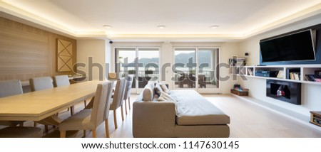 Spacious living room in modern apartment with parquet and elegant sofa. Nobody inside