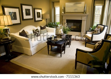 Spacious living room with fireplace and stylish decor.