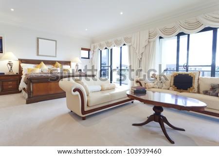 Spacious master bedroom in luxury house overlooking the water