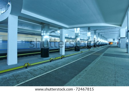 spacious modern metro station with train motion