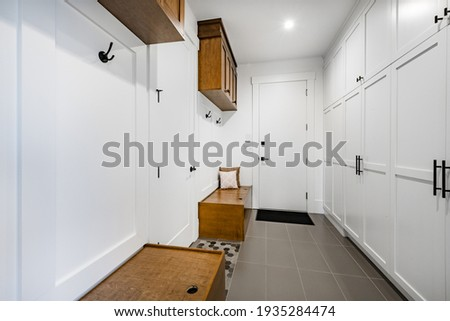 Spacious mud room with closets. benches and coat hooks Stock photo ©