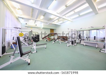 Spacious Well Lit Empty Gym With Special Equipment For Physical Training