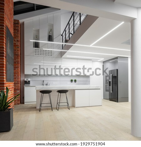 Spacious white kitchen in modern loft apartment with mezzanine floor and new lighting Сток-фото ©