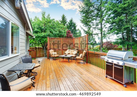 Spacious wooden deck with patio area and attached pergola. Northwest, USA