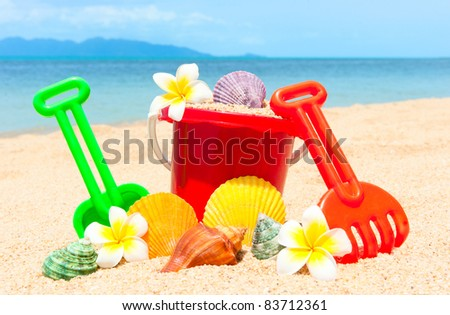 Spade and other toys on tropical beach island