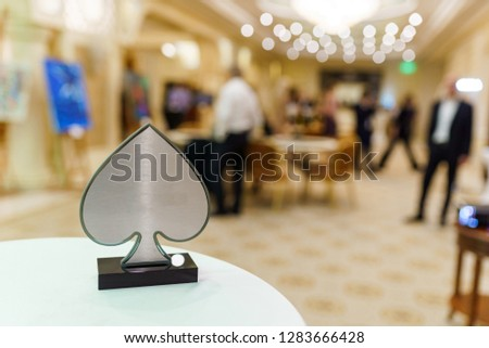 Spade metal figurine, selective focus. Beautiful trophy for winner of casino poker championship. #1283666428