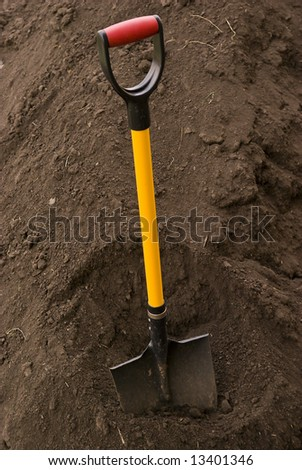 Spade putted into heap of ground
