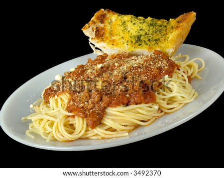 Spaghetti and Garlic Bread isolated on a black background
