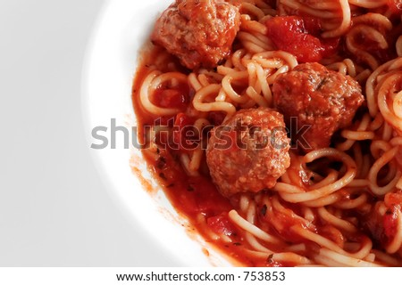 Spaghetti and meatballs in shallow dish