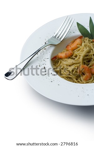 Spaghetti and prawns in a cream sauce, herb garnish. On a deep white, round bowl with wide rim sprinkled with ground pepper. Includes clipping path to change background and isolate from shadow.