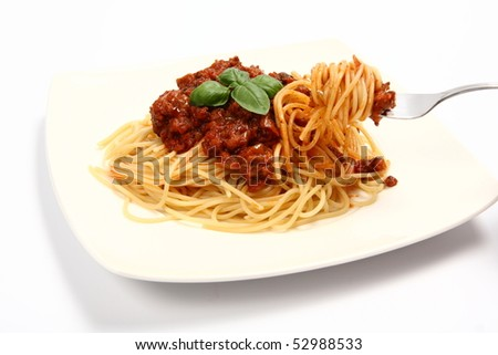 Spaghetti bolognese on a plate and some on a fork on white