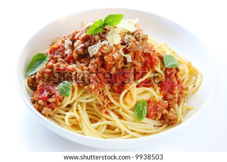 Spaghetti bolognese, topped with basil and shaved parmesan cheese. Delicious!