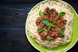 Spaghetti bolognese, traditional Italian dishes. Top view, copy space