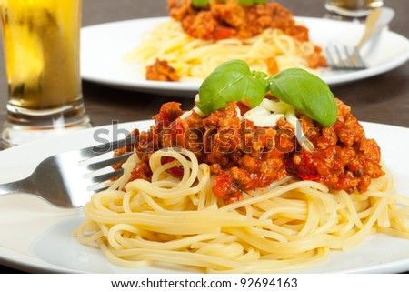 Spaghetti bolognese with glass of beer