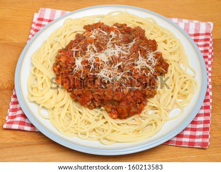 Spaghetti bolognese with Parmesan cheese.