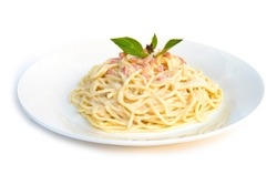 Spaghetti carbonara onion and mushroom cream sauce with ham and fresh basil  traditional Italian cuisine style side view isolated on white background