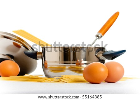 spaghetti, eggs and kitchen utensil