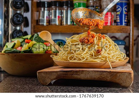 Spaghetti & Meat Tomatoe Sauce  known in Italian as ragù alla bolognese. is a meat-based sauce in Italian cuisine, typical of the city of Bologna. It is customarily used to dress tagliatelle al ragù. Сток-фото ©