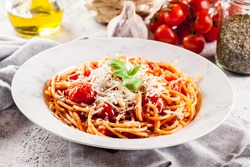 Spaghetti Napoli with parmesan cheese. Traditional italian dish