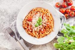 Spaghetti Napoli with parmesan cheese. Traditional italian dish
