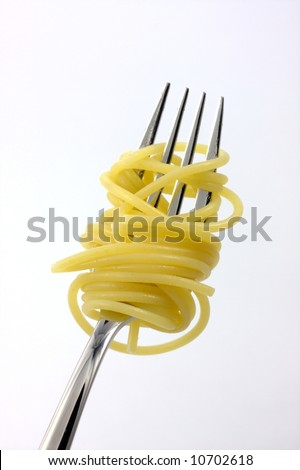 spaghetti on a fork over a white background