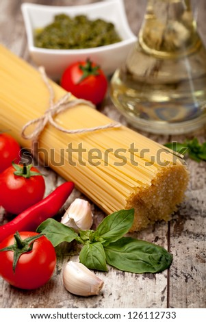 Spaghetti, on a wooden background