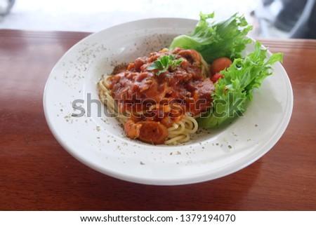 Spaghetti on dish in Cafe #1379194070