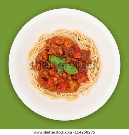 Spaghetti on plate top view with clipping path against green background - stock photo