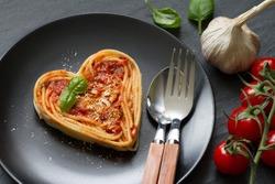 Spaghetti pasta heart love italian food diet abstract concept on black background