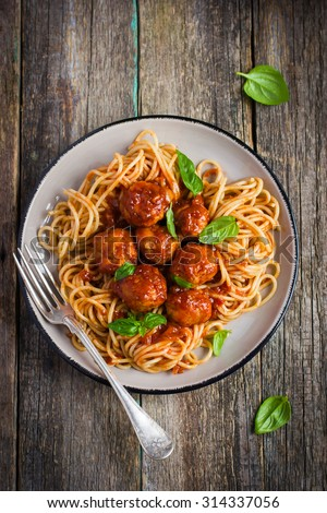 Spaghetti pasta  with meatballs and tomato sauce,  top view