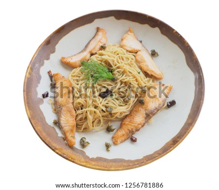 Spaghetti pesto salmon in plate isolated picture and clipping path. White background.