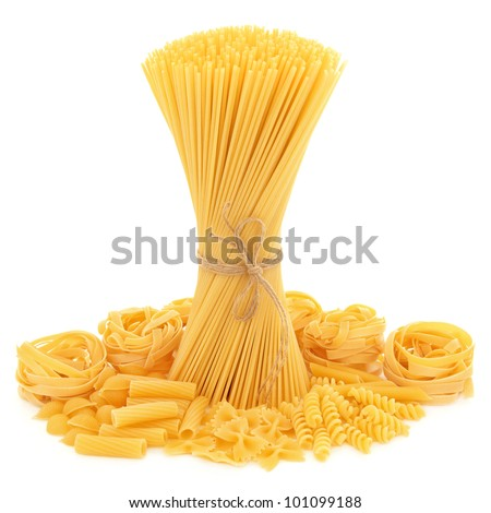 Spaghetti tied in a bunch with string and tagliatelle, conchiglie, rigatoni, farfalle, fusilli and penne pasta  scattered over white background.