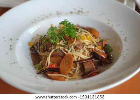 Spaghetti Vegetarian with vegetarian meat Bacon&Sausage which made from  textured Soy Protein mix Tofu and Mushroom Sprinkled with pepper