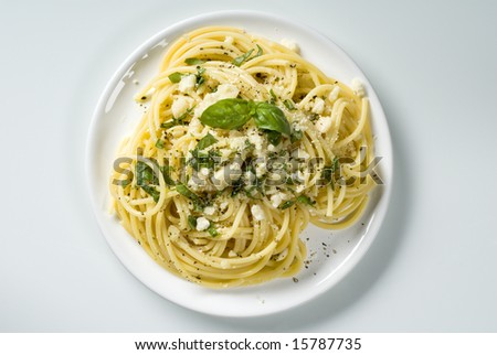 Spaghetti with cheese and  basil