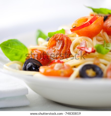 Spaghetti with cherry tomatoes and chili pepper