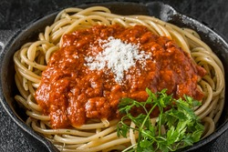 Spaghetti with meat sauce Italy home-cooked meal to make with an iron pan