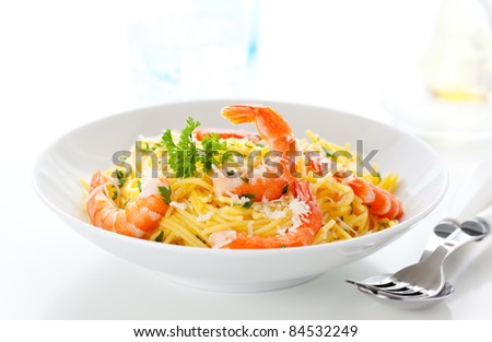 Spaghetti with prawns,cheese and herbs