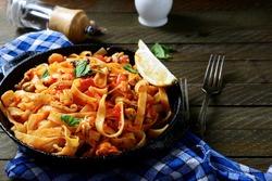 Spaghetti with seafood in a pan, mediterranean food
