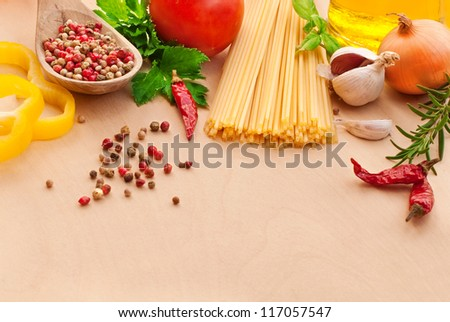 Spaghetti with spices, vegetables, olive oil and herbs
