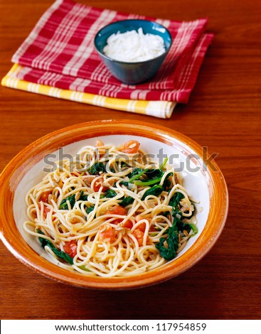 Spaghetti with tomato and spinach on a plate