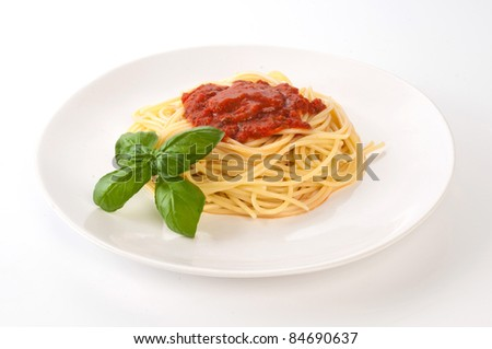 Spaghetti with tomato on  white plate