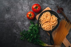 Spaghetti with tomato sauce and minced meat, Parmesan cheese and basil Black background. Top view copy space
