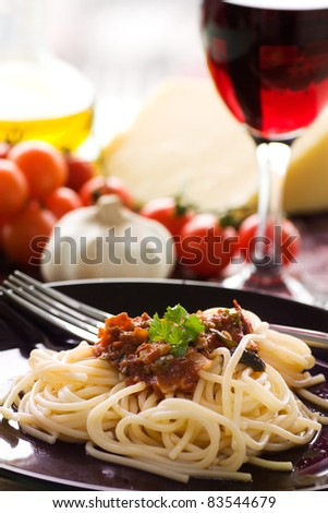 Spaghetti with tomato sauce, capers and anchovies.
