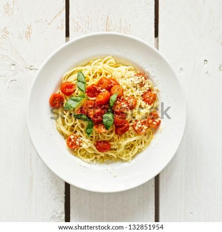 Spaghetti with tomato sauce on white wooden background #132851954
