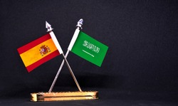 Spain and Saudi Arabia table flag with black Background