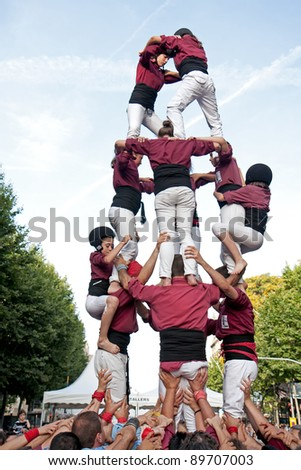 Spain, Barcelona - June 18: Traditional human towers called Castell in Catalonia. The people who build it called Castellers. Castells were declared by UNESCO. Barcelona on June 18, 2011.