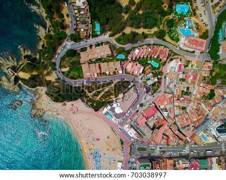 Spain beach and sea – Lloret de mar. Aerial view #703038997