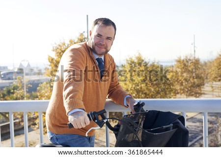 Spain, Catalonia, Barcelona, Men Portrait using a bicycle, sustainability and transportation #361865444