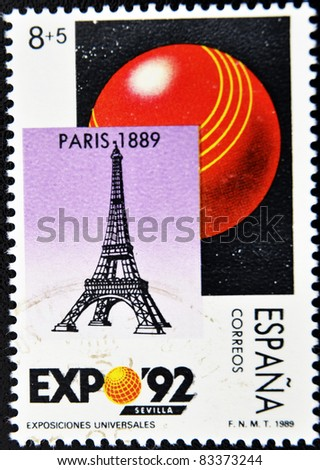 SPAIN - CIRCA 1989: A stamp printed in Spain shows the symbol of the universal exhibition in Seville and the Eiffel Tower, circa 1989
